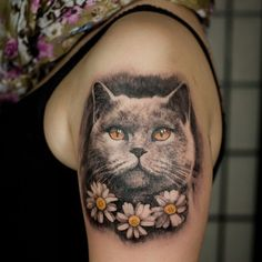 Incredibly detailed realistic cat tattoo