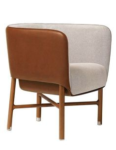 Hermès Launches a Collection of Exquisite Furnishings Designed by Philippe Nigro.  The Cabriolet chair comprises a leather-clad shell sitting on Canaletto walnut legs. (=)
