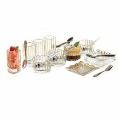 """Twelve-piece crystal taster set with twelve forks and spoons and complementing recipe card.    Product:   4 Plates  4 Bowls   4 Shot glasses  4 Forks  8 Spoons  Recipe card  Construction Material: Metal and crystalColor: ClearDimensions:  3"""" H x 2"""" W each (shot glass)Cleaning and Care: Hand wash"""