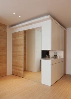inspiring modern kitchen construction inside the house with mini bar and using wooden pocket