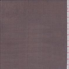 Solid dark brown. This silk fabric is sheer and very lightweight.Compare to $19.00/yd