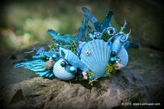Even a mermaid needs a little millinery glamour! :) Accent your flippers and shells with this fantastic tiara. Youll receive this unique base decorated with an assortment of FANTASTIC embellishments as pictured. This hat is a personal favorite of mine - so be sure to send us photos of your costume creation! SIZE: This size is suitable as an adult or child tiara. The base has built in flex. ----------------------------- I will be sending you materials of the highest quality, including…