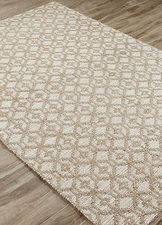 Designer Nikki Chu riffs on an intricate geometric pattern for a natural rug in a jute and chenille blend that feels as good as it looks.
