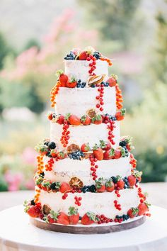 This rustic cake dripping with forest fruits. | 24 Wedding Cakes That Made 2016 So Much Sweeter