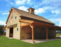 like the look of a 2 or 1.5 story barn w/ side porch.  lumber storage, firewood storage etc