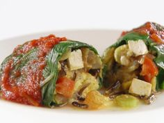 Get this all-star, easy-to-follow Moroccan-Inspired Swiss Chard Rolls recipe from Giada De Laurentiis