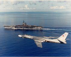 Tu-16 flying-by USS Ranger