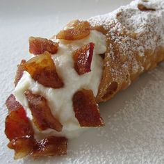Candied Bacon Cannoli The ultimate sweet-savory combo: chewy, caramelized bacon pieces paired with Ole's sweet, smooth ricotta cheese filling in a fried, crunchy pastry shell. Find it at Ole's Cannoli located inside the front entrance of Heritage Square. Caramelized Bacon, Candied Bacon, Bacon Bacon, Cannoli, New Recipes, Favorite Recipes, Bacon Recipes, State Fair Food, Minnesota State Fair