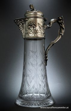Art Nouveau floral claret jug, Vienna 1900 made by Wuerbel & Czokally, Vienna - Sterling silver mounting & finely engraved crystal glass - height: 33 cm