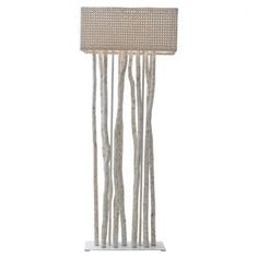 "Handcrafted wood and rattan floor lamp with a coordinating shade.  Product: Floor lampConstruction Material: Wood and rattanColor: IvoryFeatures: HandcraftedDimensions: 70"" H"