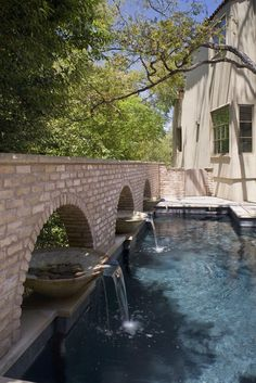 fountains in swimming pool - tips on how to convert luxury outdoor living ideas into affordable DIY projects!