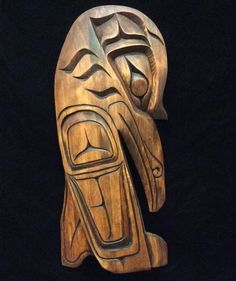 Alfred Roberstson of Kingcome Inlet hand carved this beautiful raven plaque. The raven is a mythical creature who created the sun, moon and the stars. Raven symbolizes prestige and knowledge. #raven #FirstNationsart #cedar #woodcarving #cedar