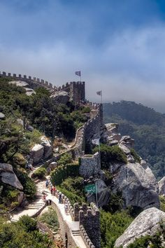 I would love to discover my family roots and tour Portugal. Castle of the Moors, Sintra, Portugal. Its fantastic to walk along on top of the wall walkway and imagine it being Sintra Portugal, Spain And Portugal, Portugal Travel, Portugal Trip, Places Around The World, Oh The Places You'll Go, Places To Travel, Places To Visit, Around The Worlds