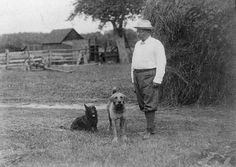 Teddy Roosevelt and two of his many dogs, 1905   A History Of White House Pets In Photographs