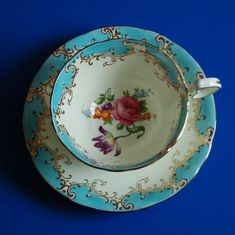 Beautiful vintage Aynsley teacup and saucer in excellent condition.    This cup is what I would call a turquoise (but everyone has a different