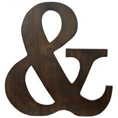 """Wood wall decor with an ampersand silhouette.Product: Wall décor   Construction Material: Wood        Color: Brown   Features:Classic typographic silhouetteRustic design    Dimensions: 21"""" H x 19.5"""" W x 1"""" D    Cleaning and Care: Wipe with a dry cloth"""