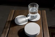 Tilt Coaster is a minimalist design created by York-based designer Snarkitecture. Appearing at first as a familiar round coaster, the angled top surface of Tilt Coaster is revealed when a drink is placed on it. (1)