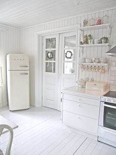 White kitchen. Simple but beautifully light & bright. Close the kitchen off with white glass paned doors