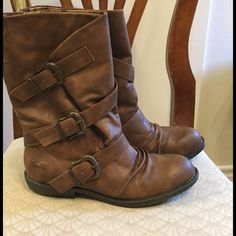 Blowfish boots NEW Brown faux leather boots with cute buckle detail, color whiskey old saddle, size 10. New in box. One little discoloration as pictured, not very noticeable as these look distressed and have multiple shades of brown. Blowfish Shoes Winter & Rain Boots