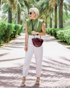 Sleeves shirt, white jeans and lace up sandals | For more style inspiration visit 40plusstyle.com