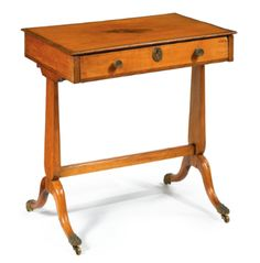 A George III inlaid satinwood writing table - Sotheby's (Brooke Astor estate)
