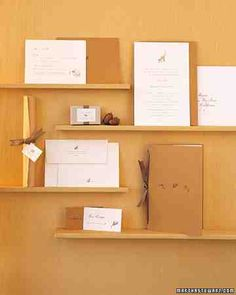 Paper and ink in shades of brown enhance the autumnal feeling of this invitation that features three different leaf motifs.
