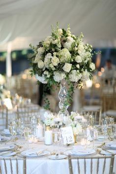 Delicieux Classic Wedding Centerpiece Idea   Tall, Clear Scones With White Roses,  Hydrangeas, Delphinium