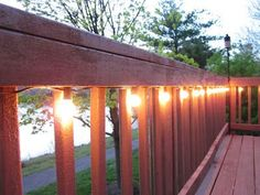DIY home improvement project for this summer: Lighting the deck using cafe lights stapled to the handrail (summer porch decor shades) Outdoor Deck Lighting, Porch Lighting, Exterior Lighting, Landscape Lighting, Deck Lighting Ideas Diy, String Lighting, Farmhouse Deck Lighting, Cafe Lighting, Island Lighting
