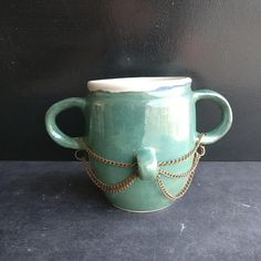 Mug with rusty chains. https://www.etsy.com/listing/609561211/the-mug-with-chains-two-handles-mug-with
