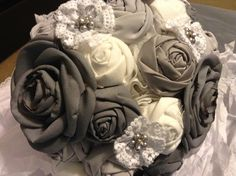 My custom fabric two tone grey and white wedding bridal bouquet with lace, pearls, and rhinestones.  Check out my board for additional views and pics of real life wedding items and decor.