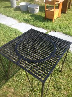 "repurposed 32"" sq floor grate table"