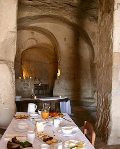 Stay or eat inside an ancient cave dwelling in Matera, Italy