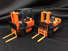 LOT INCLUDES A TOYOTA ELECTRIC FORKLIFT AND A YONEZAWA TOYS DIAPET FORK LIFT.