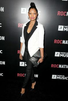 #4: Garcelle Beauvais - he Roc Nation Pre-GRAMMY Brunch at Soho House in West Hollywood, California.    Why:This tuxedo jacket and skinny black pants give Beauvais a fresh youthful feel, especially with the top knot and hot pink lips.