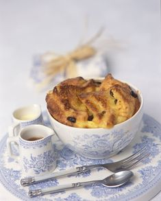 Bread & Butter Pudding is served traditionally with custard but cream or butterscotch sauce is also used. Served here in Burleigh's Asiatic Pheasants pattern makes the pudding all the more enticing to the eye and palate.   Note: British recipes call for the bread to be buttered on both sides before laying it in the baking dish.