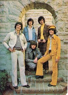 Leisure suits became very popular for both men and women in the 1970s. In the day time, many of the suits were corduroy, tweed, velvet, and bitted fabrics that were brightly colored. These suits all had wide lapels and the pants were flared at the bottom.