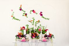 Featured on Green Wedding Shoes  photographer: Rustic White Photography // planning + design + florals: Amberly of Wrennwood Design   bright table scape with protea, bells of ireland, tulips bold colorful wedding modern bride