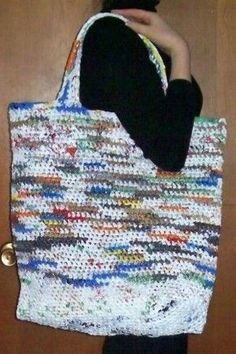 I can fit a whole week's worth of groceries in this GIGANTIC plastic tote. It is crocheted from plastic grocery sacks, and you can make your own with this simple pattern.