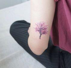 Cherry tree tattoo, back of arm