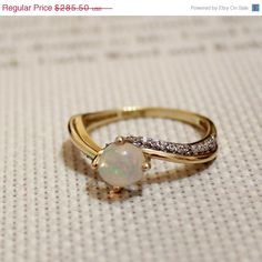 Vintage Opal Ring 14K Gold. I would much rather have an engagement/wedding ring like this than a big diamond.