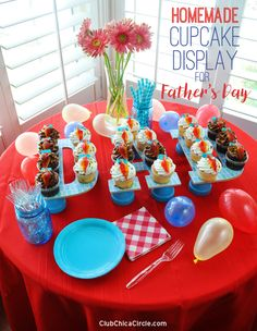 DAD Father's Day cupcake display easy DIY and craft idea. Mod Podge big letters and prop up with painted upside-down terra cotta pots to create a personal one-of-a-kind cupcake stand. #givebakery