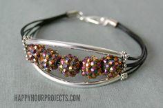 10-Minute Glittering Tube Bead Bracelet   Video Tutorial  http://happyhourprojects.com/glitter-bead-bracelet/