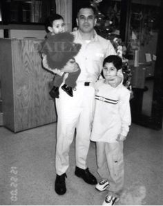 """Another image featured in the book """"Shadow of My Father"""" by John (Junior) Gotti shows John (Junior) Gotti with his son and holding his daughter while being held at Ray Brook Prision in Mafia, John Junior, Life Of Crime, Family Photos, Couple Photos, Al Capone, Gangsters, Great Photos, Photo Galleries"""