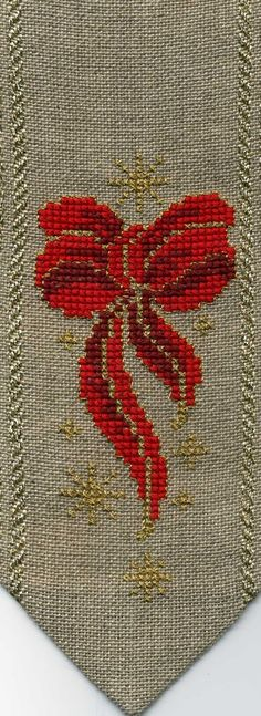 Beautiful cross stitched red bow