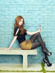 "bestcelebritylegs: "" Karen Gillan gorgeous legs in a gold mini skirt, stockings and sky high heels """
