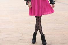 Bright pink skirt + printed black tights + black booties, cute!