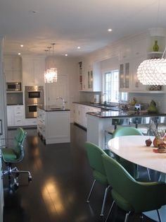 colorful chairs in mostly white kitchen