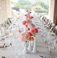 Milk white bud vases with coral pink peonies, pink hydrangea, coral and peach roses