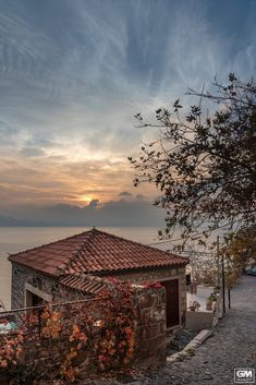 Sunset in Molyvos, Lesvos island, Greece Greece, Island, Explore, Sunset, House Styles, Glass, Photography, Greece Country, Photograph