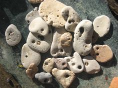 Hag Stones, also known as Witch Stones, Fairy Stones, Holy Stones and Eye Stones, are stones with naturally formed holes running clean through them. These holes are usually formed by centuries of wave action and/or dripping water. Crystals And Gemstones, Stones And Crystals, Wishing Stones, Mystical World, Hag Stones, Powerful Love Spells, Lucky Stone, Eye Stone, Stone Art